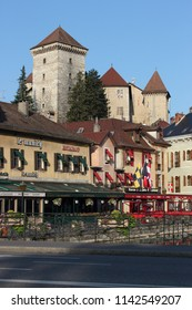 ANNECY, HAUTE SAVOIE / FRANCE JUILY 22 2018: from the boat quays, morning view of the old castle and the brewery and restaurant on the banks of the Thiou