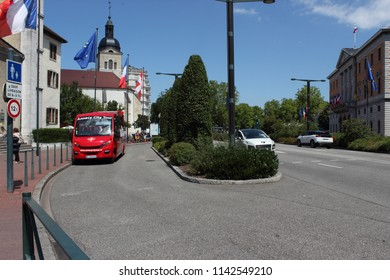 ANNECY, HAUTE SAVOIE / FRANCE JUILY 22 2018: the red shuttle that takes tourists for a city tour from the old town opposite the town hall
