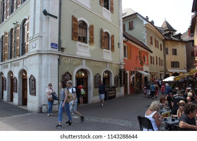 ANNECY, HAUTE SAVOIE / FRANCE JULY 22 2018: in the street behind the famous glacier, we flank and eat in a quiet and relaxed atmosphere