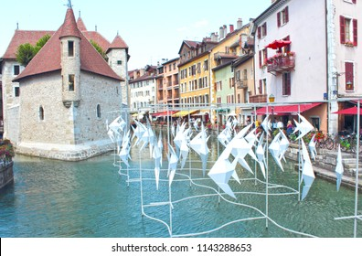 ANNECY, HAUTE SAVOIE / FRANCE JULY 22 2018: the old town and the palace of the island are the witnesses of the work of the artist Antoine Milian, the flying fishes in giant origami
