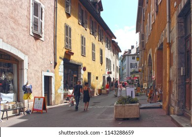 ANNECY, HAUTE SAVOIE / FRANCE JULY 22 2018: at the beginning of the chateau and the porte pérrière, the alleys abound with authentic art and craft shops or not