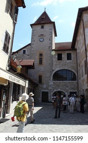 ANNECY, HAUTE SAVOIE / FRANCE JULY 22 2018: Tourists from Asia flock to the entrance of the old prisons of the island's palace in the old town for the visit