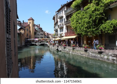 ANNECY, HAUTE SAVOIE / FRANCE JULY 22 2018: typical view of the old town and canals, market day
