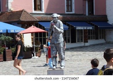 ANNECY, HAUTE SAVOIE / FRANCE JULY 22 2018: street artist in the old town, under a burning sun