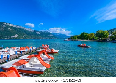 Annecy, Haute-Savoie, Auvergne-Rhône-Alpes / France - September 12, 2014: Pedal boats on Lake Annecy, one of the largest and cleanest lakes in France, seen from the Jardins de l'Europe park.