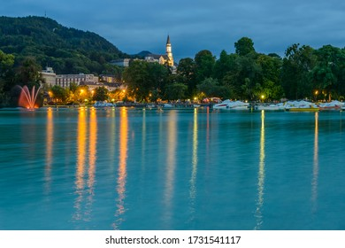 Annecy, Haute-Savoie, Auvergne-Rhône-Alpes / France - September 13, 2014: Lake Annecy and elevated early 20th-century Catholic Basilica of the Visitation (Basilique de la Visitation), at dusk.
