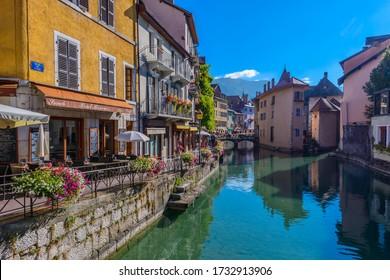 Annecy, Haute-Savoie, Auvergne-Rhône-Alpes / France - September 13, 2014: The River Thiou, Quai de l'Ile, Passage de l'Ile bridge and Vieille Ville (the old town) viewed from the Pont Morens.