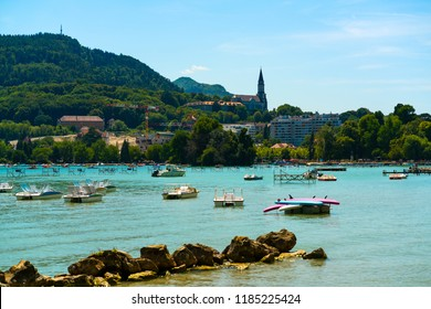 Annecy lake view with town in background with church tower