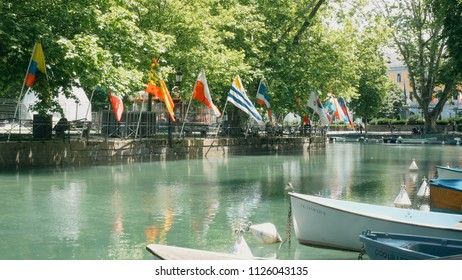 Annecy/France-05-16-2018: view on boats and flags at the lake in Annecy, France