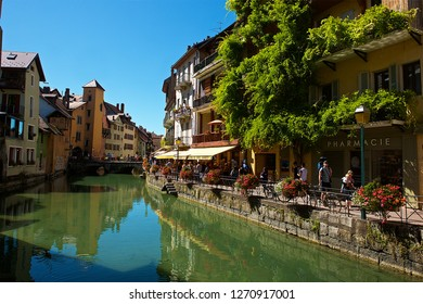 """Annecy,France-08 22 2016:Sometimes called """"Venice of the Alps"""", this idyllic and touristic representation of Annecy comes from the Thiou river lying through the old city ."""
