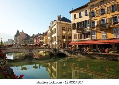 Annecy,France-08 23 2016: Facade buildings reflection in the water of the Thiou river in the old town of Annecy.