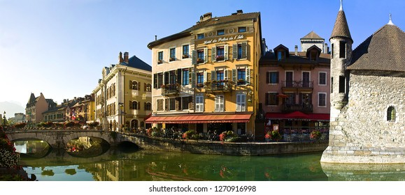 """Annecy,France-08 23 2016:Called """"Venice of the Alps"""",this idyllic representation of Annecy comes from the Thiou river lying through the old city,and a 12th century castle:the Palais de l'Isle."""