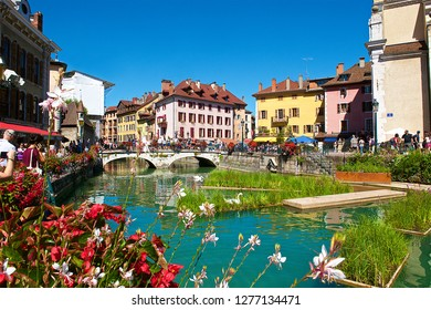 """Annecy,France-08 23 2016:Sometimes called """"Venice of the Alps"""", this idyllic and touristic representation of Annecy,comes from the Thiou river lying through the old city."""
