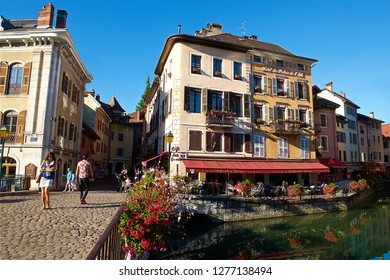 """Annecy,France-08 23 2016:Sometimes called """"Venice of the Alps"""", this idyllic and touristic representation of Annecy,comes from the Thiou river lying through the old city"""