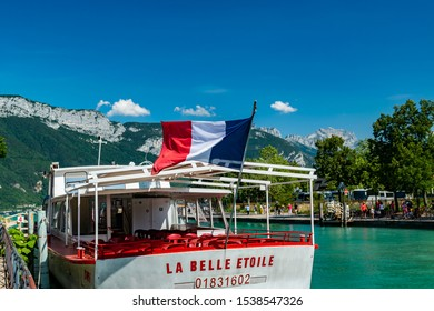 Annecy,FRANCE-August 05,2019:View of a cruise ship, river, lake, tourists and mountains from the city of Annecy.Annecy is the largest city of Haute-Savoie department.