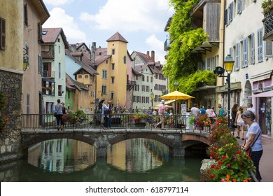 Annency, France: July 27th, 2016: Picturesque old town bridge and tourists in Annency city during summer time, France
