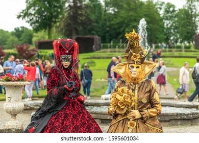 ANNEVOIE GARDENS, BELGIUM - June 9, 2019: Women standing in masks and masquerade costumes during Venetian carnival in Annevoie  gardens, Rue des jardins, 37 a, Annevoie/ Belgium