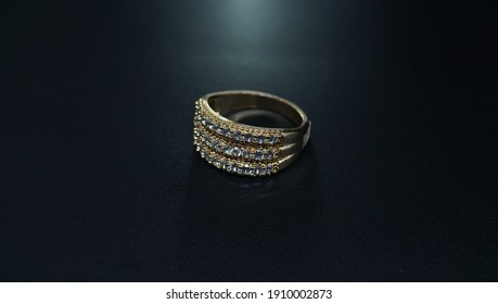 anniversary ring with a luxurious and elegant model on a black background
