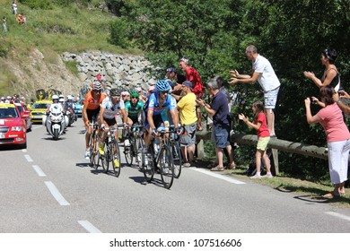 ANNONAY, FRANCE - JUL 13: J.C. Peraud, E. Martinez, C. Gauthier, R. Kiserlovski, D. Millar in stage 12 of Le Tour de France 2012. David Millar wins the race on July 13, 2012 in Annonay Ardeche, France