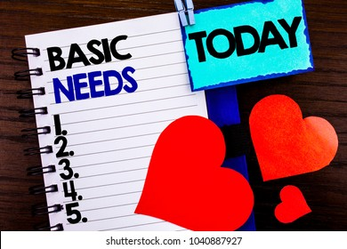 Announcement text showing Basic Needs. Concept meaning Health In Developing Countries Essential Food Lack written notebook book paper the wooden background Today Love Heart.