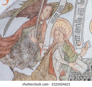 The announciation, the angel Gabriel comes to Mary, a wall-painting from about the year 1500 in the church of St. Mary, Elsinore, Denmark, May 14, 2019