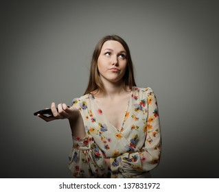An annoyed and frustrated woman on the phone