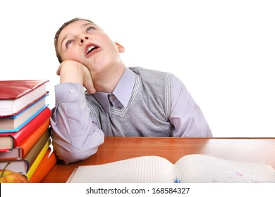 Annoyed Kid on the School Desk on the white background