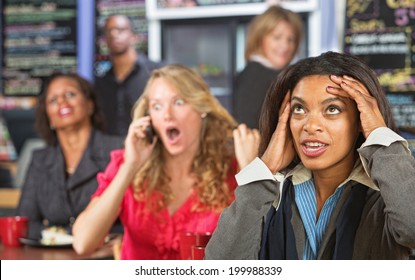Annoyed lady listening to obnoxious woman on phone