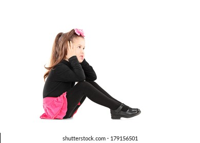 Annoyed little girl covering her ears isolated on white background