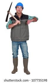 Annoyed man holding axe