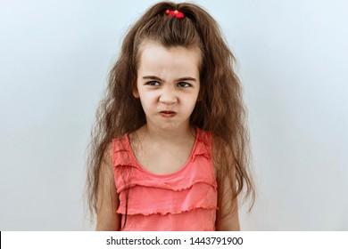 Annoyed and upset emotion. Headshot portrait of little girl against white background