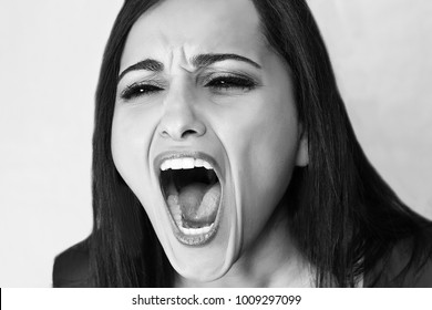 Annoyed woman screaming, face expession, emotional portrait