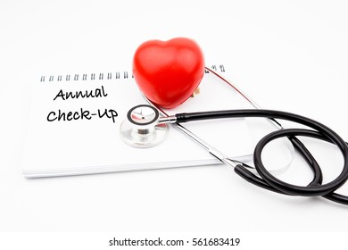 ANNUAL CHECK UP wording on notebook with red heart and stethoscope, health medical technology information concepts