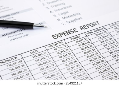 Annual expense report with pen pointing at EXPENSE REPORT word
