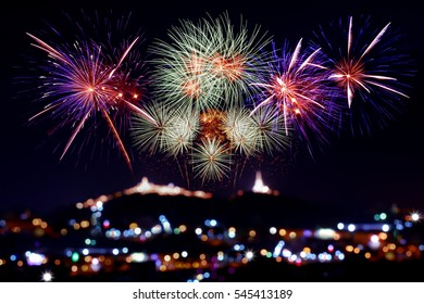 annual firework displaying on blur bokeh background of temple firework sparkling in dark sky celebrating