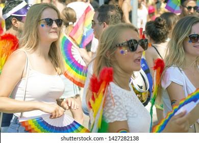 The annual parade LGBT. Girls lesbians walking in the Gay Pride parade. Parade of tolerance. Rainbow flags at Gay pride parade. 14 June 2019. Tel Aviv. Israel.