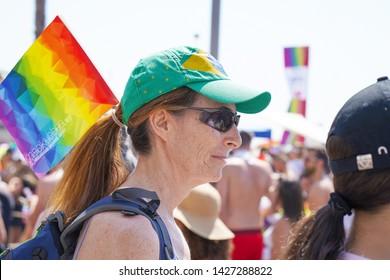 The annual parade LGBT. Portrait of Elderly woman lesbian walking in the Gay Pride parade. Parade of tolerance. Rainbow flags at Gay pride parade. 14 June 2019. Tel Aviv. Israel.