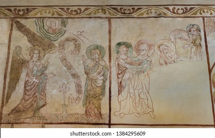 Annunciation to the Blessed Virgin Mary and  the visit of the Virgin Mary to St. Elizabeth , a 500 years old gotic mural in Tirsted church, Denmark, April 17, 2019