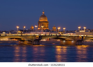The Annunciation Bridge and the dome of St. Isaac's Cathedral in the night scenery. Saint-Petersburg, Russia