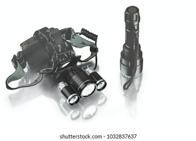 anodized aluminium waterproof tactical flashlight and headlamp on white background