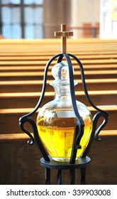 Anointing oil displayed inside a place of worship.