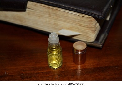 Anointing oil near to holy bible.