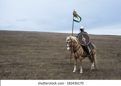 Anonymous ancient sarmatian horseman with spear in steppe