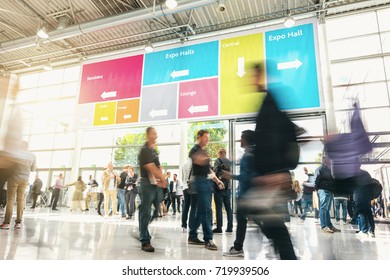 Anonymous Blurred businesspeople at a trade fair