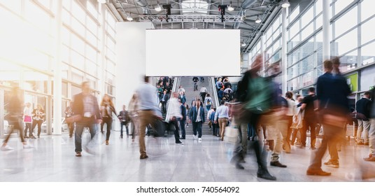 anonymous blurred people at a tradeshow