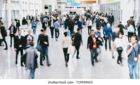 anonymous blurred people walking in a modern hall of a Exhibition