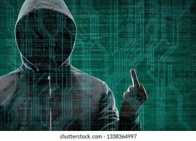 Anonymous computer hacker over abstract digital background. Obscured dark face in mask and hood. Data thief, internet attack, darknet fraud, dangerous viruses and cyber security .