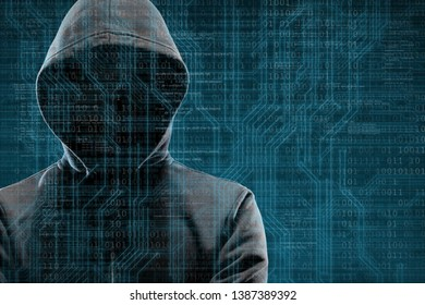 Anonymous computer hacker over abstract digital background. Obscured dark face in mask and hood. Data thief, internet attack, darknet fraud, dangerous viruses and cyber security.