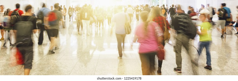 Anonymous crowd of people walking on a busy City street