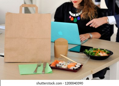 Anonymous delivery food service in the office - employees on lunch break order food to eat in the office during the work